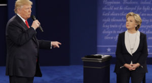 Republican presidential nominee Donald Trump answers Democratic presidential nominee Hillary Clinton during the second presidential debate at Washington University in St. Louis, Sunday, Oct. 9, 2016. (AP Photo/John Locher)